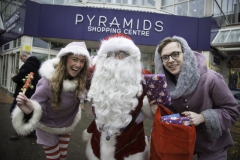 SANTA ARRIVES AT THE PYRAMIDS SHOPPING CENTRE, BIRKENHEAD.... Pictured is Santa with two of his helpers Twinkle (Laurie Coughlin) and Snowdrop (Ollie Thomas).