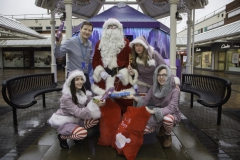 SANTA ARRIVES AT THE PYRAMIDS SHOPPING CENTRE, BIRKENHEAD.... Pictured is Santa at his Grotto with helpers Sparkle (Amy Brumskill), Snowdrop (Ollie Thomas), Twinkle (Laurie Coughlin) and Keelan Early fundraiser from Claire House Hospice.
