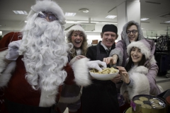 SANTA ARRIVES AT THE PYRAMIDS SHOPPING CENTRE, BIRKENHEAD.... Pictured trying out some buscuits with Marcus Clerc from M&S .