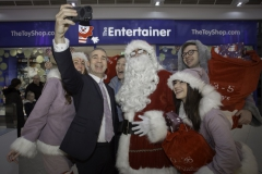 SANTA ARRIVES AT THE PYRAMIDS SHOPPING CENTRE, BIRKENHEAD....Pictured  taking a Santa Selfie  is  Derek Millar shopping centre Director, with Santa ,Twinkle (Laurie Coughlin),  Keelan Early fundraiser for Claire house Hospice, Snowdrop (Ollie Thomas) and Sparkle (Amy Brumskill) .