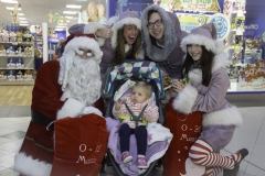SANTA ARRIVES AT THE PYRAMIDS SHOPPING CENTRE, BIRKENHEAD... Pictured is  Lilly Jones,1 from Morton with Santa, Twinkle (Laurie Coughlin), Snowdrop (Ollie Thomas) and Sparkle (Amy Brumskill).